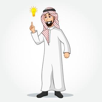 アイデアを持っていることのシンボルとして明るいアイデア電球を指している伝統的な服でアラビア語のビジネスマンの漫画のキャラクター。孤立した