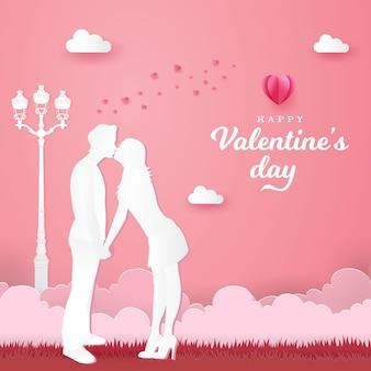 バレンタインのグリーティングカード。ロマンチックなカップルがキスをし、ピンクに手を繋いで