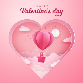 バレンタインのグリーティングカード。ロマンチックなカップルはキスをし、刻まれた心と気球のバスケットの中に立っています。