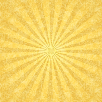 Желтый гранж-фон с лучами