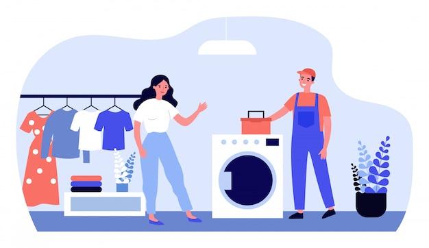 Работник техобслуживания ремонтирует стиральную машину
