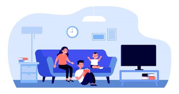 家でテレビを見て幸せな子供