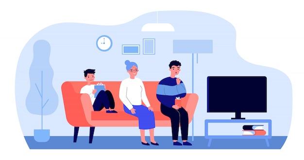Счастливая семья смотрит телевизор у себя дома