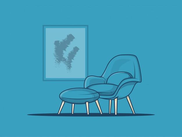 青い壁にフォトフレームとリラックスできる椅子