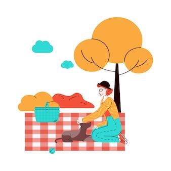 ペットの犬とピクニック、スケッチスタイルのイラストの女性