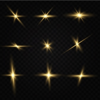 黒の背景に分離された輝く黄金の星。エフェクト、グレア、ライン、グリッター、爆発、黄金の光。図。