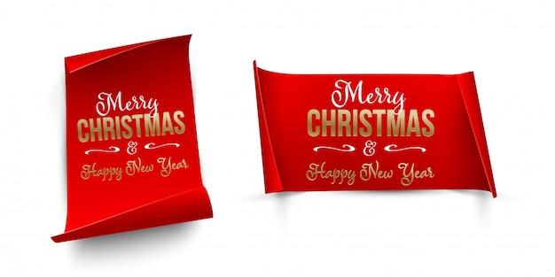分離された湾曲したエッジを持つ垂直方向と水平方向の赤い紙にゴールデンメリークリスマスと新年あけましておめでとうございますテキスト