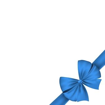 白い背景で隔離の休日に青いリボン。美しいお祝い弓。