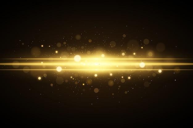 Абстрактный волшебный стильный световой эффект на черном фоне. золотая вспышка с бликами боке. рождество свечение. светящаяся летящая пыль.