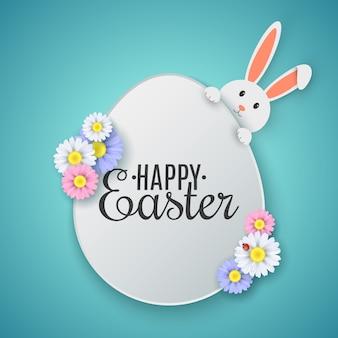 ハッピーイースターのテキストとイースターエッグ。春の花とかわいい漫画のウサギ。
