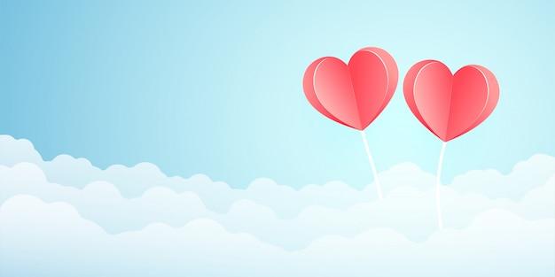 Два оригами розовый бумажный шар сердце формы летать на небе над облаком. день святого валентина праздничная открытка.