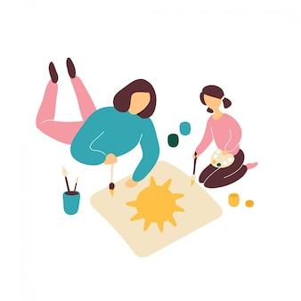 Мать рисует с маленькой дочкой на полу