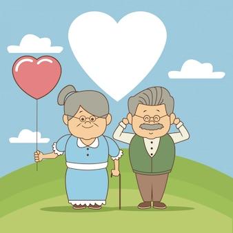 草の中の心臓の形のバルーンで幸せな祖父母の日