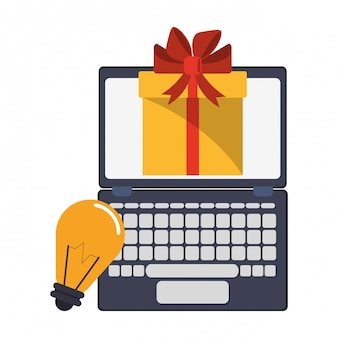 ギフト用の箱と電球の光のシンボルとノートパソコン