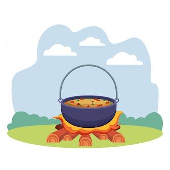 たき火のキャンプフードで調理スープ