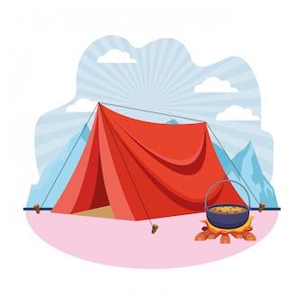 たき火のキャンプテントとスープの調理