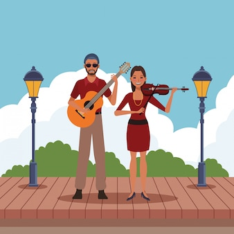 ギターとバイオリンを弾くミュージシャン