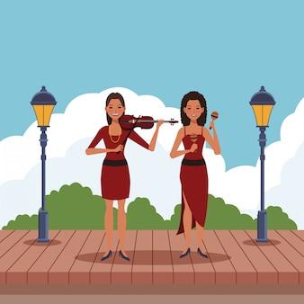 バイオリンとマラカスを演奏するミュージシャン