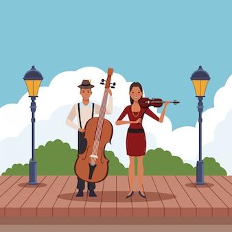 ベースとバイオリンを弾くミュージシャン