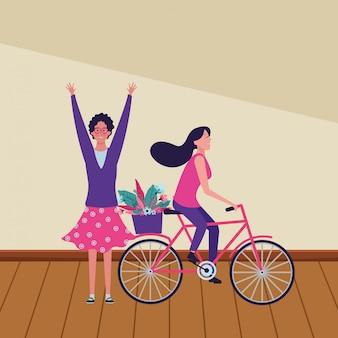花と自転車に乗る女性