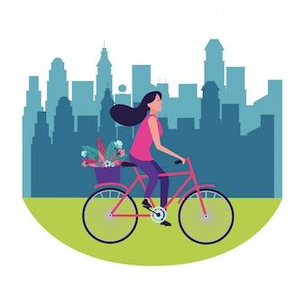 花を持つ女性乗馬自転車
