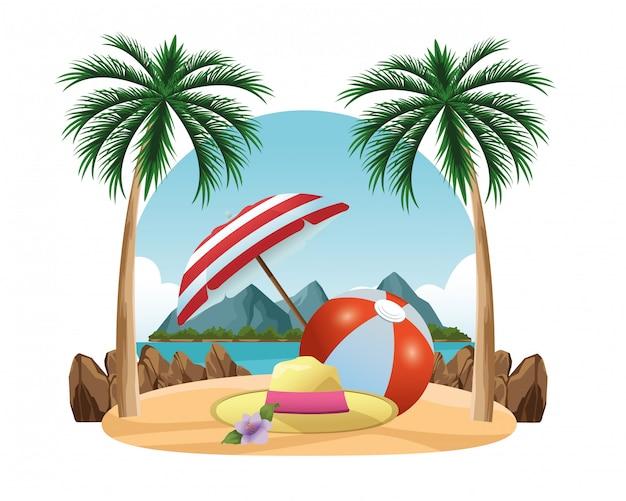 夏の帽子と傘の下のビーチボール