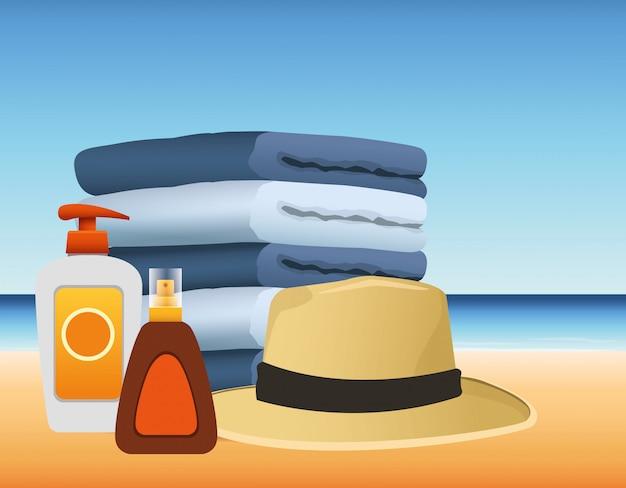 Летнее время на пляжном отдыхе: полотенца, шляпа от солнца, бронзер и крем от загара