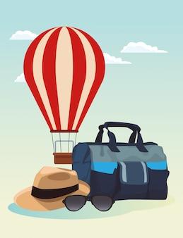 旅行バッグと帽子、カラフルなデザインの熱気球