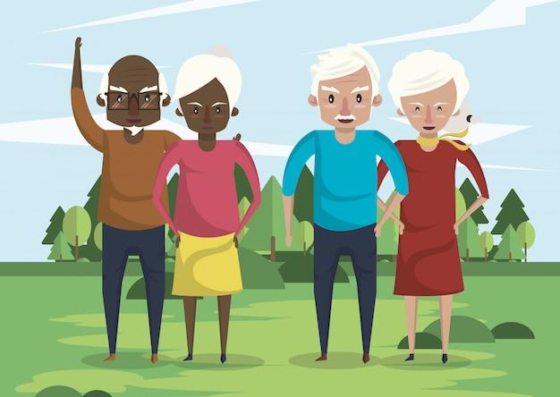 フィールドに異人種間の祖父母カップルのグループ