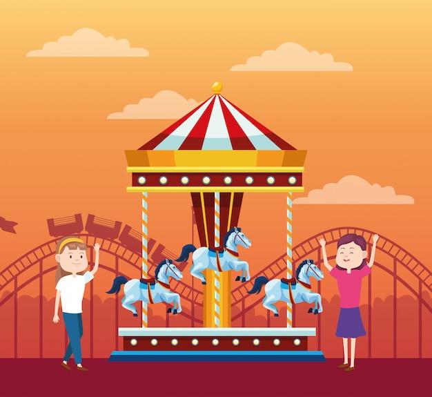Счастливые девушки на ярмарке рядом с каруселью