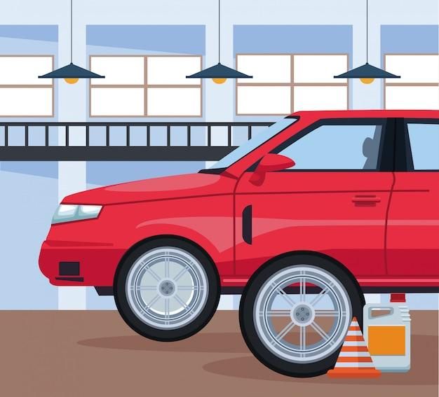 赤い車とトラフィックコーンとオイルボトルと車修理店の風景