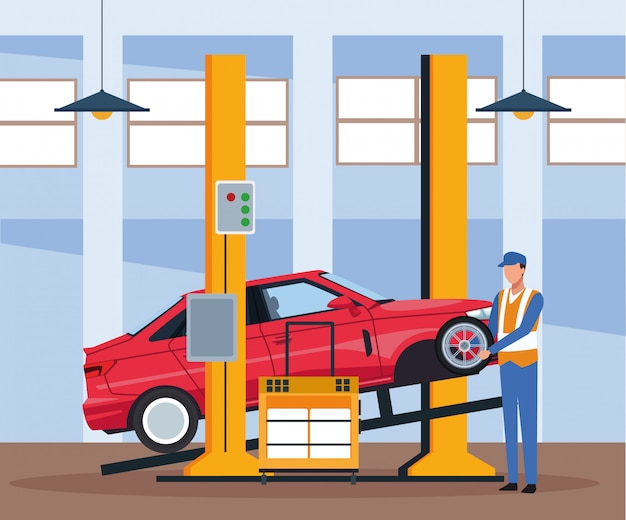 持ち上げた車と車のタイヤを扱うメカニックと車修理店の風景