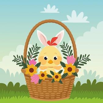 Пасхальная открытка с маленьким птенцом и ушками кролика в корзине
