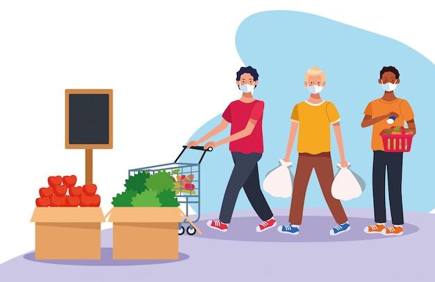 フェイスマスクとスーパーで買い物をする男性