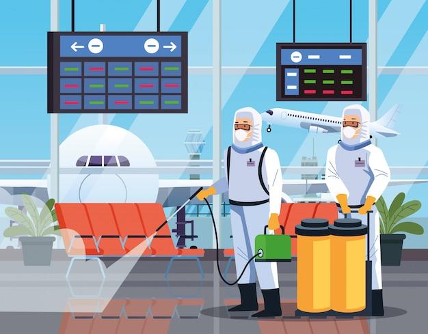 Работники по биобезопасности дезинфицируют аэропорт для