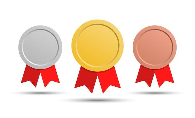 Медали золотая, серебряная и бронзовая медаль. медали с красными лентами.