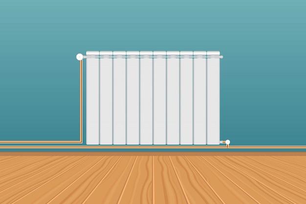 青い壁に現実的な白い暖房ラジエーター