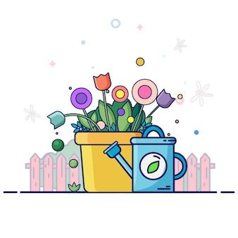 園芸工具のある春の風景-色の花、緑の植物、青い水まき缶。