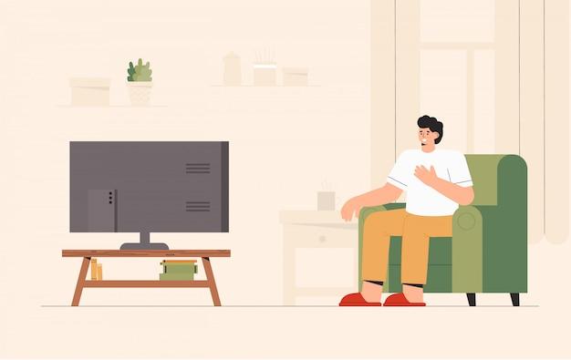 居心地の良い部屋で自宅でテレビのニュースを見てソファに座っている男。衝撃的な内容、否定的なニュース。