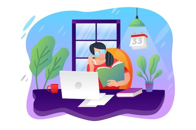 Девушка сидит в кресле работает с ноутбуком