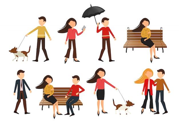 秋の公園の人々、犬の散歩、椅子で話す人々、愛するカップルの散歩、傘を持つ男、秋の公園の大きなセットカジュアルな人々、