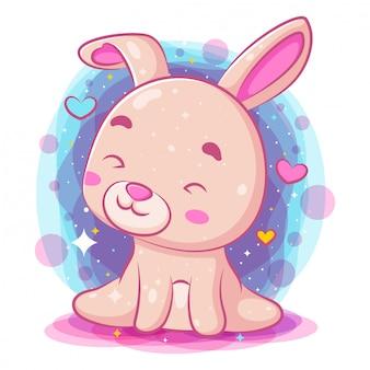 座っていると笑顔のかわいい赤ちゃんウサギ