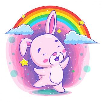 虹の背景で踊るかわいいウサギ