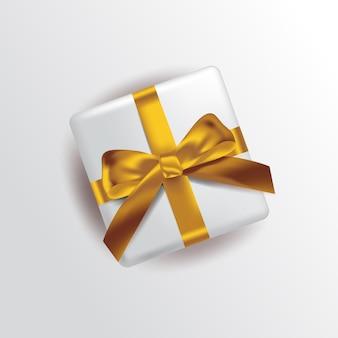 図。ゴールドリボン付きの白いギフトボックス。