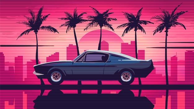 Ретро автомобиль едет среди пальм на фоне заката в городе.