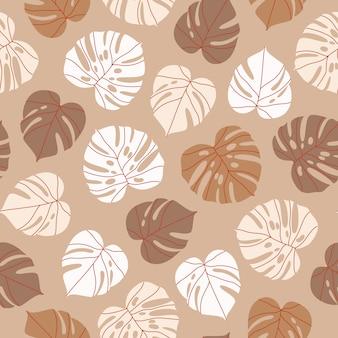 ベージュのモンステラの葉のシームレスなパターン。