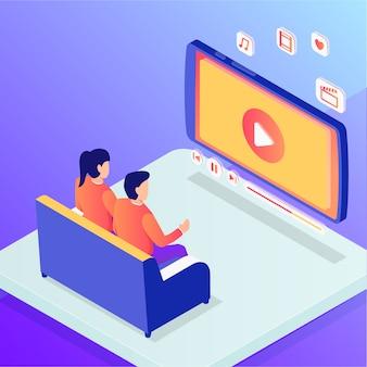 カップルの男性と女性がオンラインでホームエンターテイメント映画を見て