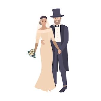 Элегантная невеста одета в изысканное свадебное платье, а жених одет в роскошный фрак и цилиндр.