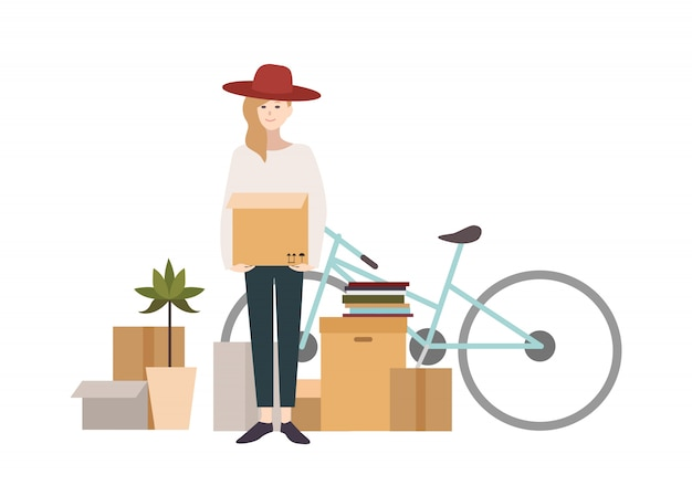 Молодая девушка переезжает в новый дом с вещами. мультфильм иллюстрация в плоском стиле.