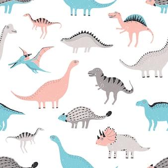 面白い恐竜のシームレスなパターン。かわいい幼稚な恐竜の背景。カラフルな手描きのテクスチャです。